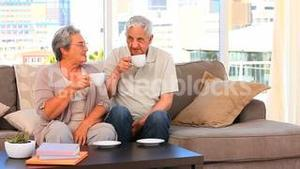 Retired couple drinking a cup of tea