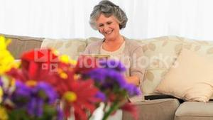Woman looking at her photo frame