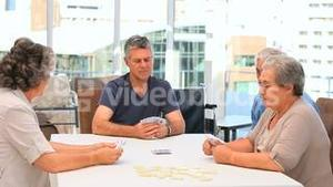 Mature friends playing cards