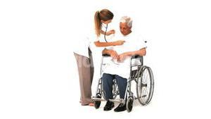 Nurse with her male patient in wheelchair