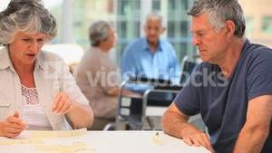 Mature couple playing dominos