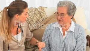 Nurse talking with her senior patient