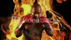 Tough boxer punching with red gloves
