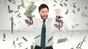 Composite video of businessman holding money bags