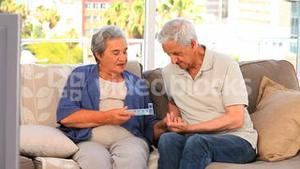 Couple with their pills box