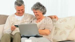 Happy couple buying on the net