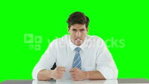Worried businessman banging his fists