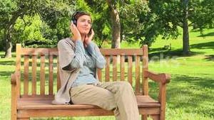 Young woman listening to music outdoors