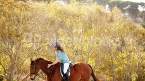 Pretty smiling woman riding horse