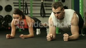 Fit couple in plank position