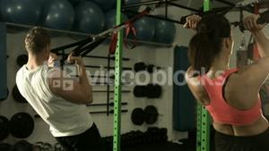 Fit couple working out together