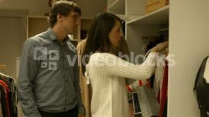 Cute couple looking at clothes together