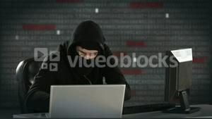 Composite video of hacker using laptop