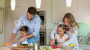 Attentive parents and their children cooking together