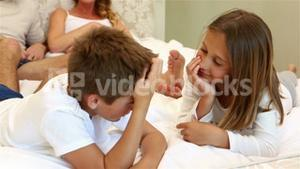 Happy family discussing on the bed