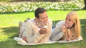 Young couple eating icecream and laughing