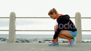Woman tying up her shoe laces