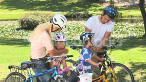 Family preparing to go cycling