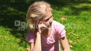 Young girl thinking outdoors