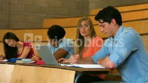 Students sitting beside each other while learning