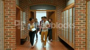 Students walking down hallway to locker