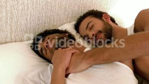 Gay couple relaxing in the bed