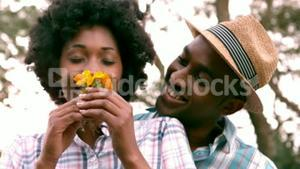 Happy couple with flowers bouquet