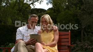 Affectionate couple sitting on bench