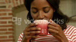 Relaxed young woman drinking coffee