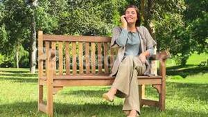 Young girl phoning outdoors