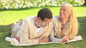 Young couple talking outside