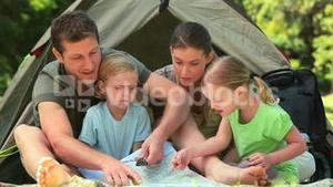 Cute family camping in the countryside