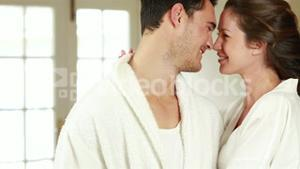 Attractive couple hugging with affection