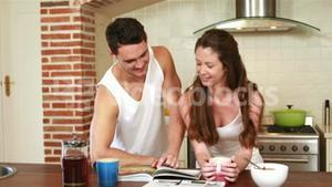 Happy couple reading the newspaper together