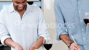 Homosexual couple cooking together