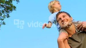 Son on his fathers shoulders