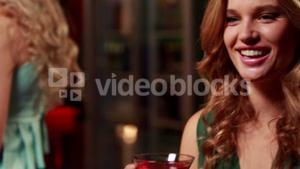 Smiling woman drinking cocktail