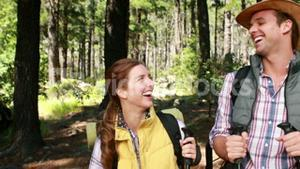 Hiker couple with walking stick