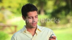 Happy man on mobile phone