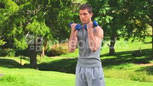 Handsome male doing musculation exercises