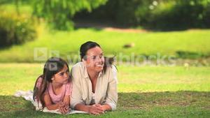 Mother and daughter chatting outdoors