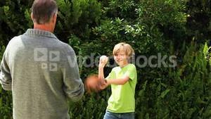 Father and son playing with a baseball ball
