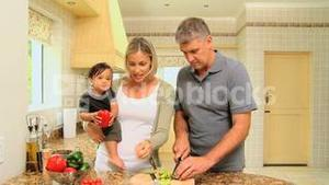 Baby with parents tasting vegetables