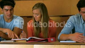 Happy students studying in library