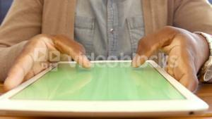 Mans hands using tablet
