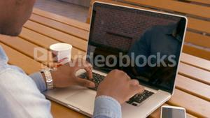 Over shoulder view of man using laptop