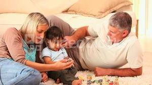 Baby discovering blocks with his parents