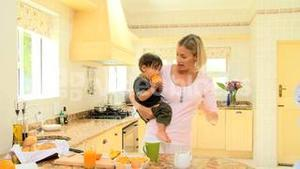 Hurried man leaving wife and child in kitchen and going to work