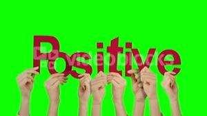 Hands holding up positive