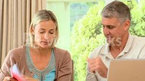 Couple disagreeing about bills